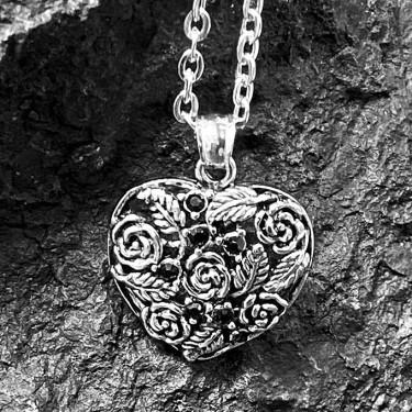 Pendentif acier inoxydable coeur sur fleur